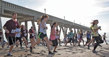 Lumina News file photo. Runners start the McGregor 5k, benefitting the Daniel McGregor Scholarship Fund at the University of North Carolina Wilmington, March 22, 2014 at Johnnie Mercer's Pier.