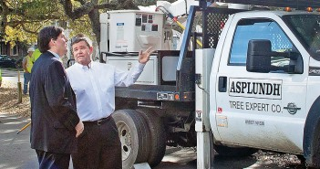 Lumina News file photo. Alderman Hank Miller and Wrightsville Beach Mayor Bill Blair observe tree trimming efforts on Live Oak Drive by Duke Energy Tuesday, March 17.