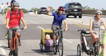 Lumina News file photo. Cyclists of all ages travel across the Heide Trask Drawbridge near the end of the River to Sea Bike Ride May 3, 2014.