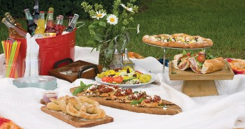Lumina News file photo. A spring picnic is laid back and still elegant with wood serving platters, a wildflower centerpiece and vintage-style sodas.
