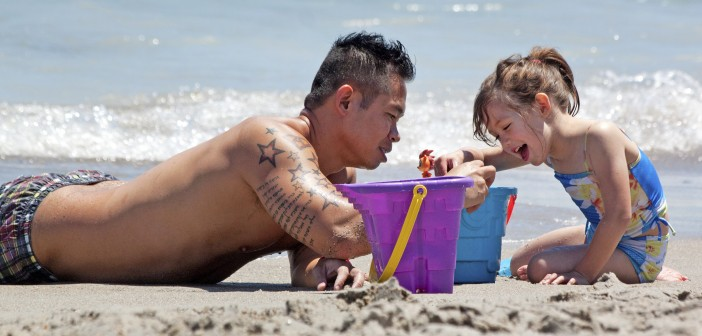 Massive, but well-behaved crowds relax on Wrightsville