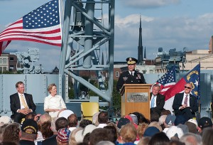 Staff photo by Allison Potter. Major General Greg Lusk, adjutant general of North Carolina, speaks to the crowd gathered on the Battleship North Carolina for the 50th annual Memorial Day Observance Monday, May 25. Lusk is joined on stage by Capt. Terry A. Bragg, executive director of the Battleship North Carolina; Susan Kluttz, secretary of the Department of Cultural Resources; Sen. Richard Burr and Capt. Wilbur D. Jones, Jr., chairman of the USS North Carolina Battleship Commission.