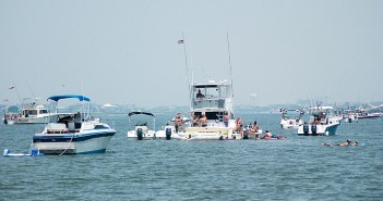 Lumina News file photo. People relax on their boats with friends near Masonboro Island July Fourth weekend 2012.