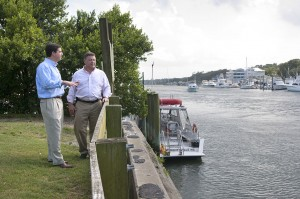 Staff photo by Allison Potter. Congressman David Rouzer, left, and Transportation and Infrastructure Committee Chairman Bill Schuster survey the Intracoastal Waterway south of Heide Trask Drawbridge at Wrightsville Beach Friday, June 19, following a morning tour of the Port of Wilmington with a press conference, and a boat ride to Southport and back with the Army Corps of Engineers.