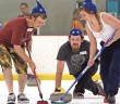 Staff photo by Emmy Errante. A curling team participates in the Fourth Annual Lighthouse Beach-Spiel at Wilmington Ice House Saturday, June 20.