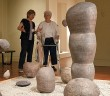 Staff photo by Allison Potter. Docent Margi Gerlach, left, leads Betty Thomas through an exhibit of Hiroshi Sueyoshi's work at the Cameron Art Museum Monday, June 29.