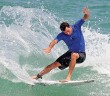 Lumina News file photo. Ben Bourgeois, Wrightsville Beach local pro surfer and winner of the 9th annual O'Neill Sweetwater Pro-Am, completes a turn on a wave during the final pro heat of the contest July 13, 2014.