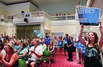 Staff photo by Allison Potter. The audience at the Wilmington City Council meeting Tuesday, July 21 applauds as council members vote in favor of a resolution opposing offshore drilling and seismic testing off the North Carolina coast.