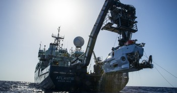 The research vessel Atlantis with the submersible Alvin hanging off its stern..