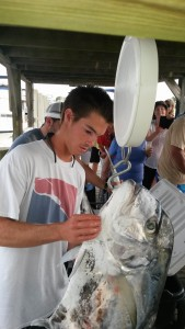 Mark Winneberger weighs his 36.3 lb African pompano Saturday at the Wrightsville Beach Spearfishing Tournament at Seapath Marina. Winneberger caught the fish on a 90 foot free dive. He is also president of the UNCW spearfishing club.