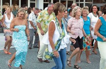 Lumina News file photo. The Imitations lead guests through line dances during Lumina Daze at the Blockade Runner Beach Resort Aug. 24, 2014.