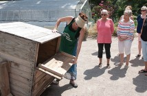 Staff photo by Allison Potter. Heather Kelejian, director of the New Hanover County Arboretum's Ability Garden, explains how to use a compost tumbler during a workshop Friday, Aug. 21.