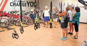 Staff photo by Emmy Errante. YMCA members admire the new TRX classroom at the Express Y Sunday, Aug. 30.
