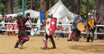 Staff photo by Simon Gonzalez. Fighters entertain the crowd with their combat techniques at the Sweet Raids Medieval demonstration, hosted by the Shire of Seareach, Saturday, Aug. 29 at the Hugh MacRae Park equestrian ring.