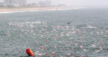 Lumina News file photo. Hundreds of competitors in the Wilmington Family YMCA Pier-2-Pier swim race north from Crystal Pier to Johnnie Mercer's Pier Sept. 13, 2014.