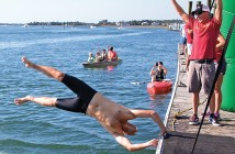 Lumina News file photo. A competitor dives into the water to begin the third annual Swim the Loop Oct. 11, 2014 at Wrightsville Beach.