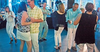 Staff photo by Emmy Errante. Guests dance at the Last Chance for White Pants Gala Saturday, Aug. 29 at Audi Cape Fear.