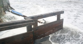 Staff photo by Emmy Errante. High surf washes over Wrightsville Beach's public access eight Monday, Oct. 5.