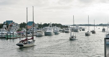 Staff photo by Allison Potter. Sailboats hailing from home ports in the northeast U.S. head south in the Intracoastal Waterway following an opening of the Heide Trask Drawbridge Thursday, Nov. 5.