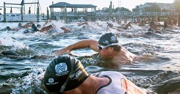 Athletes swim through Banks Channel at the start of the Wilmington YMCA Sprint Triathlon Sept. 19.