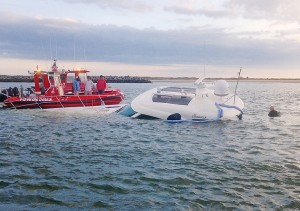 """TowBoat U.S. recovers """"Somewhere in Time,"""" a 60-foot Sea Ray, from the north jetty at Masonboro Inlet Oct. 31."""
