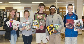 Staff photo by Terry Lane. After receiving a grant to upgrade the Noble Middle School library with nonfiction books, administrators turned to the students to help make selections, each adding personal experiences and input into the process. From left, Ella Gordon, seventh grade, selected books about the arts, including books on cooking and acting; Taylor Chism, sixth grade, selected titles on women's sports like soccer and lacrosse; Tanner Jones, eighth grade, and Elijah Sutton, eighth grade, focused on sports books, including some on their favorite teams; Alex Beste, eighth grade, selected titles on science and history, including an updated book on dinosaurs and graphic novels on mythology.