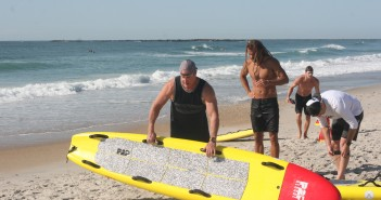 Wrightsville Beach Ocean Rescue Director Dave Baker, left, tests a new rescue paddleboard design from local maker Prone 2 Paddle.