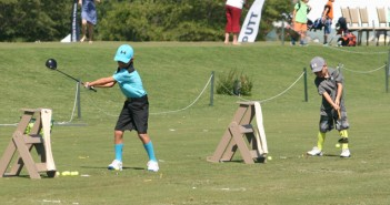 Cooper and Casey Arnold of Lexington, S.C. sport fashionable and colorful gear as they compete in the Country Club of Landfall's Drive, Chip & Putt youth competition on Thursday. Staff photo by Terry Lane.