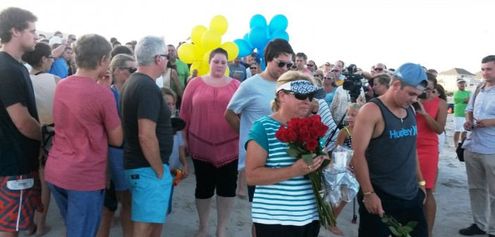 """Friends, family gather on Wrightsville Beach to pray for """"miracle"""" for missing swimmer"""
