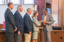 Supplied photo. The New Hanover County Board of Commissioners honor Capt. Clarence Hayes, who retires this week after 33 years with the New Hanover County Sheriff's Office.