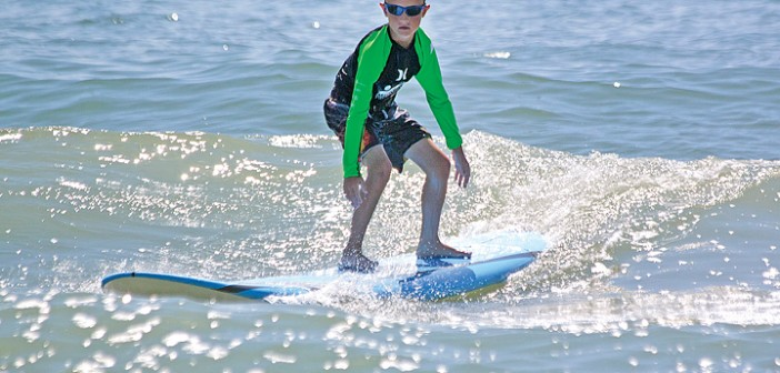 Pro surfers spread stoke, healing at WB