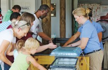 Photo by Katie Dickens. Visitors learn about local sea life at the North Carolina Coastal Federation's Touch Tank Tuesdays event at the Fred and Alice Stanback Coastal Education Center on Aug. 9.