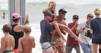 """Supplied photo. Katelyn Sewell, 13, is """"chaired"""" off the beach by her father and a family friend in Nags Head, N.C., after winning the Menehune longboard championship at the Eastern Surfing Association Championships on Friday, Sept. 23."""