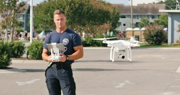 Staff photo by Terry Lane. Wrightsville Beach firefighter Sam Proffitt demonstrates the Phantom 3 Advanced unmanned aerial vehicle at the town fire department on Saturday, Sept. 17. Proffitt will write a report on the drone's use by first responders in rescue situations for Pennsylvania State University, which donated the drone to the department.