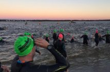Swimmers at the start of the PPD Ironman North Carolina in Wrightsville Beach's south end on Saturday morning. Staff photo by Allison Potter.