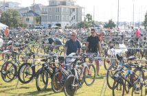 Triathletes on Friday get prepared for the PPD Ironman, which will impact Wrightsville Beach traffic on Saturday, Oct. 22. Staff photo by Terry Lane.