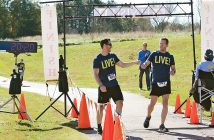Supplied photo. Kirk Smith, right, and Ryan Marsh finish the Free to Breathe 5k in Athens, Ga. in 2015. Smith, diagnosed with stage 3B lung cancer in 2013, will compete in the PPD IRONMAN North Carolina 70.3 on Saturday, Oct. 22.