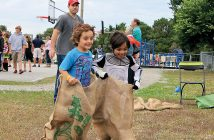 Lumina News file photo. Wrightsville Beach School students Noah Kagan, left, and Aidan Smith hop to the finish line in a sack race at the school's annual Fall Fest on Nov. 1, 2013.