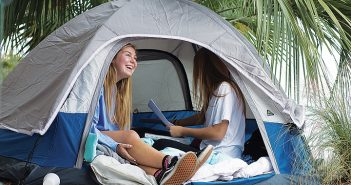 Photo by Johanna Ferebee. Blaine Blackburn, left, and Anna Bateman, both Sophomore UNCW students, camp out in front of Bryant Real Estate offices on N Lumina Avenue Tuesday, Nov. 29, in hopes of obtaining a rental property on Wrightsville Beach.