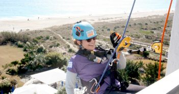 Allison Mason, a teacher at DREAMS of Wilmington, rappels down the Blockade Runner Beach Resort on Saturday.