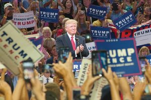 Lumina News file photo. Republican presidential candidate Donald J. Trump takes the stage at the University of North Carolina Wilmington's Trask Coliseum Aug. 9, 2016.