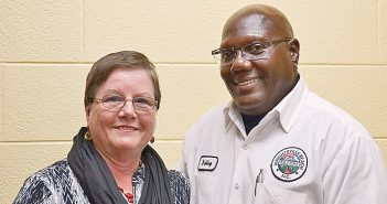Staff photo by Terry Lane. The Town of Wrightsville Beach recognized Sylvia Holleman, town clerk, and William Bailey, facilities maintenance supervisor, for 25 years of service during the town's annual holiday luncheon last week.